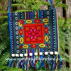 The rustic lover will be thrilled with this handmade tribal inspired bag.   The colourful textures with wood beading immediately catch the eye.   These colourful bags are made on traditional looms with 100% natural cotton.  The beautiful unique ethnic based theme and natural colours of brown, greens and blue will attract plenty of attention.  The shoulder strap is also an embroidered design that can be placed on your shoulder or across your chest.  They have a zip fastening and internal… Tribal Bags, Spiritual Gifts, Incense, Purses And Bags, Shoulder Strap, Ireland, Ethnic, Beading, Angels