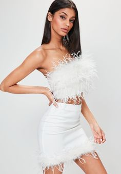 This one's taking centre stage! With its bright white hue, fluffy Ostrich feathe… This one's taking centre stage! With its bright white hue, fluffy Ostrich feather hem and figure-flattering fabric, this luxe mini skirt is a new season superhero. Couture Dresses, Fashion Dresses, Feather Fashion, Feather Dress, Crop Top Outfits, Bustier, Kpop Outfits, Festival Outfits, Ball Gowns