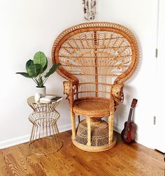 Super cool and gorgeous vintage wicker peacock chair!!! With Flared back and beautiful scrollwork detailing, this chair will truly be a statement piece to any room in your home or office. Structure is sturdy and in great shape. It only has some unraveling on one side of the arm rest as shown in photos, However this doesnt affect its use. ~Dimensions: 41 W  56 H   Please contact us for shipping quote prior to buying.  ~ Local Pickup is FREE. We are located Atlanta, GA.  ~Greyhound Freight…