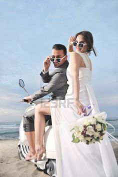 Picture of wedding scene of bride and groom just married couple on the beach ride white scooter and have fun stock photo, images and stock photography. Wedding Images, Wedding Pics, Wedding Shoot, Wedding Themes, Wedding Couples, Married Couples, Wedding Fun, Wedding Vendors, Pre Wedding Poses