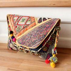 MOBOR by NAWERI 119€ Boho clutch made from antique embroidered fabrics with a removable strap. Pochette confectionnée à partir de tissus brodés antiques. Chaîne amovible. Modèle unique.