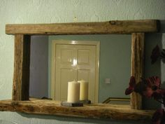 Large Chunky Framed Driftwood Mirror with Candle shelf  Our most popular Mirror   Chunky solid wooden frame with beautiful erosion and weathered charachteristcs  Hand finished in natural bees wax   Features 12cm deep shelf for candles or nic nacs  Dimensions 110cm x 60cm  £159.00