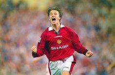 David Beckham celebrates a United goal in 1996.
