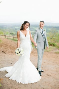 we adore this bride's fishtail lace wedding dress