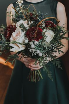 Bridesmaid bouquet with silver brunia, Quicksand roses, black pearl pomponis, eryngium thistle, curly willow & cedar! A great bouquet for a winter wedding at Emerald Lake Lodge! Photo: http://enterthekingdom.ca/ Bouquet: www.flowersbyjanie.com