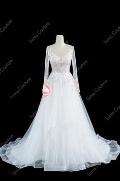 e688f8f2f2669 Illusion Long Sleeve Sequined Lace Tulle Wedding Dress with Ruffled Chapel  Train