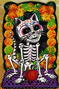 Skeleton cat framed in marigolds with a red ball of yarn