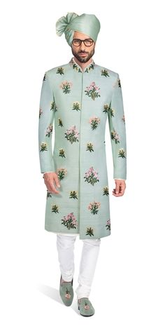 The painstaking intricacy and detail can be seen in the variety of techniques used to bring this multi-colored Sherwani together. All of this on a pastel teal raw silk base gives this elegant outfit a playful look. Indian Groom Dress, Wedding Dresses Men Indian, Wedding Dress Men, Wedding Suits, Indian Formal Wear, Indian Bridal Wear, Indian Wear, Latest Kurta Designs, Mens Kurta Designs