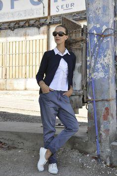 ReNika wearing: AT.P.CO pants, Allude sweater, Prada shirt, Natural World sneakers, Furla bag, Pandora bracelet