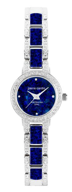 Women's silver tone round case watch, featuring crystals on case and bracelet, with predominantly blue Opal dial and band.