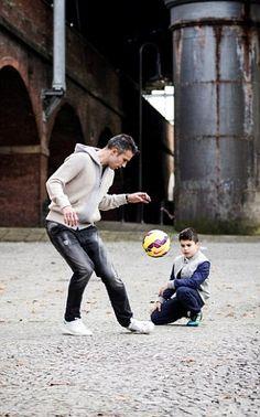 Robin Van Persie and son Shaqueel...