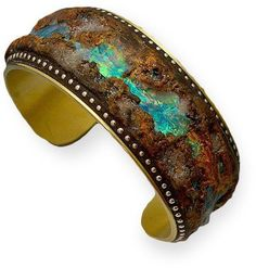 Boulder Opal Bracelet by Liz Hall. Made from polymer clay, brass, iridescent media and sterling silver beads. It's hard to believe how realistic this looks.