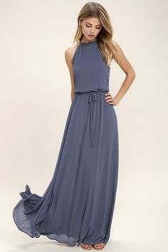 The Be Mellow Denim Blue Maxi Dress is here to help you stay fabulous and centered! Breezy woven poly falls from a drawstring halter neckline with back keyhole. Drawstring waistline flows into a full maxi skirt. Beaded ties.