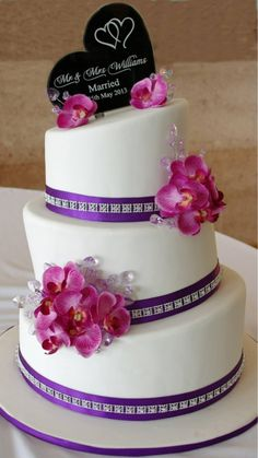 Purple and white topsy turvy wedding cake
