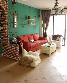 red sofa turquoise walls