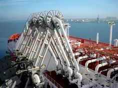 Loading Arms connected to Manifold of LNG Tanker