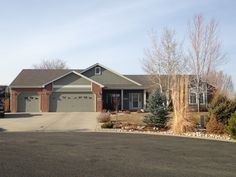 This home in Loveland that we roofed has Weathered Wood GAF Timberline HD shingles on it.