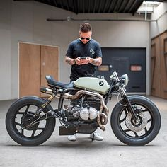 "@arjanvandenboom from Ironwood Motorcycles checking out @caferacersofinstagram with his recent build ""The Mutant"", an aggressive BMW R80. Notice the exhaust work done by @pisanggoreng1980  Thanks for the photos, more to come! . Photo by @paul_vanml. . . #croig #caferacersofinstagram #caferacer"