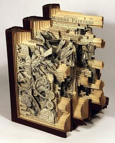 Brian Dettmer carves exquisite sculptures from out-of-date encyclopedias, medical journals, illustration books and dictionaries