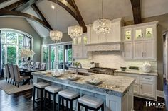 You will be the talk of the town as you entertain in the gourmet kitchen that boasts custom lighted cabinets and top-of-the-line Thermador and Sub Zero appliances, including a cabinet-front refrigerator, professional gas range, ovens, griddle and wine ref New Kitchen, Kitchen Dining, Kitchen Decor, Kitchen Ideas, Awesome Kitchen, Kitchen Layout, Barn Kitchen, Dining Area, Style At Home