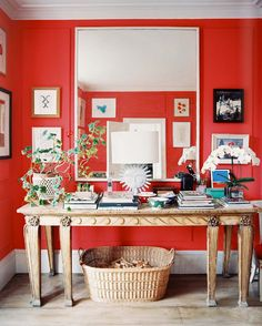 details a like: a shock of red (!), a six-legged table, a plant with long branches • Cath Kidston's home in London • as seen in Lonny magazine, via the Alkemie blog