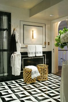 Kips Bay - black and white graphic floor with gold stools by Jamie Herzlinger