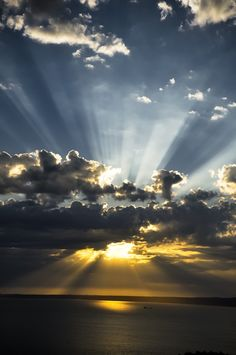 sunrays at sunset with clouds lights trace sunbeams. Wall Mural - Vinyl - Themes