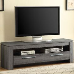 You'll love the Chaoyichi TV Stand at AllModern - With Great Deals on modern Living  products and Free Shipping on most stuff, even the big stuff.