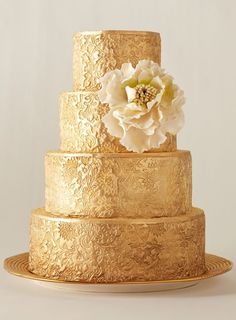 """Gold wedding cake with flower. We can help achieve this look at Dallas Foam with cake dummies, cupcake stands and cakeboards. Just use """"2015pinterest"""" as the item code and receive 10% off your first order @ www.dallas-foam.com. Like us on Facebook for more discount offers!"""