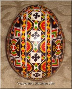 This pysanka has many sun and field symbols indicating a wish for protection against sickness and harm and a good harvest.  The butterfly is a symbol of a carefree childhood, as well as the journey of the soul into eternal happiness.