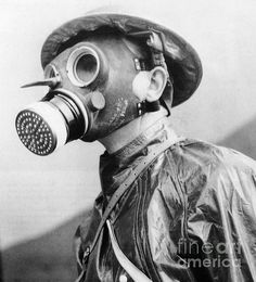 British soldier wearing a gas mask and protective suit in 1940