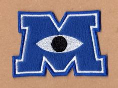 This Monsters University Logo Patch is just one of the custom, handmade pieces you'll find in our patches shops. Monster University, University Logo, Star Monsters, Monsters Inc, Velcro Patches, Pin And Patches, Patch Shop, American Children, Cute Pins