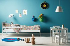 KRITTER children's furniture, including a bed and a table