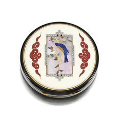GEM-SET, ENAMEL AND DIAMOND POWDER COMPACT, BLACK STARR & FROST, 1930S The circular hinged case of oriental design, applied to the centre with a mother-of-pearl plaque inlaid with carved lapis lazuli, hard stone and abalone shell, depicting a bird on a flowering branch, the frame millegrain-set with rose-cut diamonds, the case further decorated with cream, red, green and black enamel, diameter approximately 58mm depth approximately15mm, signed Black Starr & Frost, restoration to enamel.