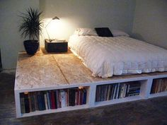 Diy Bed Frame With Bookcase Ideas...kind of like this, but no extra on the side of the mattress and shelving along the side as well