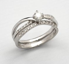 0.40pt claw set Diamond engagement and wedding ring set.
