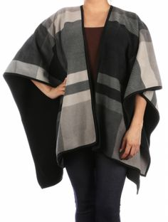Black Fleece Finish Cape Shawl. Black Fleece Finish Cape Shawl This Black lined cape shawl makes a great fashion statement. You will love the soft and comfortable fit that gives you freedom to move around. The lined detail creates a look you will love and goes with so many different outfits. Ponchos are hitting the top in the fashion industry this season and capes and shawls line up right next to them. Wear it long and loose or wrap it up shorter in the front to create a…