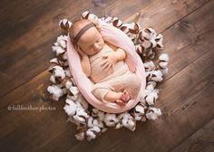 Newborn portrait on wood floor with cotton ball wreath. Toddler Pictures, Newborn Pictures, Baby Pictures, Baby Photos, Newborn Pics, Newborn Shoot, Newborn Photo Props, Newborn Photography Poses, Feather Photography