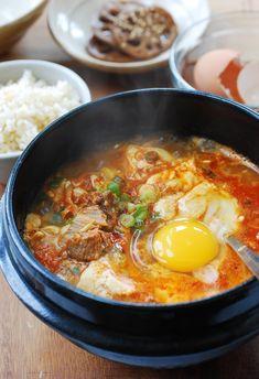 Kimchi Soondubu Jjigae Korean silken tofu stew with a raw egg on top Related posts: Korean soft tofu with kimchi stew (Soondubu Jjigae) Kimchi Jjigae (Kimchi Stew) Instant Pot Kimchi Jjigae (Stew) Der Klassiker Kimchi Jjigae – HEALTHY FOOD – Korean Soup Recipes, Asian Recipes, Korean Soft Tofu Soup Recipe, Chinese Recipes, Thai Recipes, Soondubu Jjigae, Eat This, Korean Dishes, Asian Cooking
