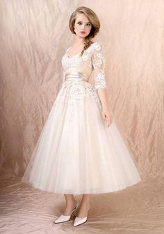 bridal tea length bridal dress with sleeves / http://www.deerpearlflowers.com/top-35-most-loved-tea-length-wedding-dresses/