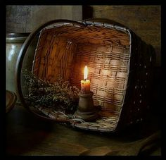 Simply Prim...old basket & candlelight.