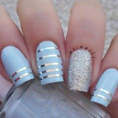 Blue and silver striped nail art