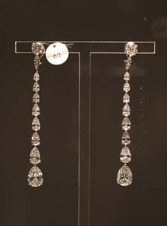 Diamond Earrings and Necklace by Cartier from ELIZABETH TAYLOR'S JEWELRY COLLECTION. Elizabeth Taylor wore the Cartier diamond earrings (of her own design) to her 8th and final wedding to Larry Fortensky at Michael Jackson's Neverland Ranch in 1991.