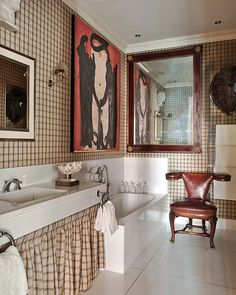 pleated skirt beneath the sink -- Bathroom in the Madrid home of antique dealer Alfonso Icaza