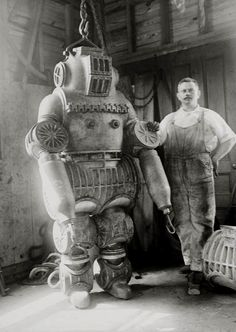 chester e. macduffee next to his newly patented • 250 kilo diving suit 1911