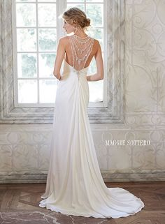 Ethereal chiffon sheath wedding dress with glittering Swarovski crystals, draped over an illusion neckline and back. Deandra by Maggie Sottero.