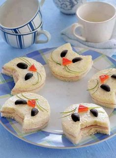 Make your favorite sandwich, use a cat shaped cookie cutter.  The eyes are olives, nose a bell pepper triangle and thin chive slivers for the whiskers.