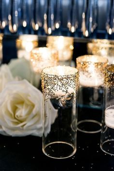 Add glitter to a simple votive for a little sparkle at your wedding.  Pinned by Afloral.com