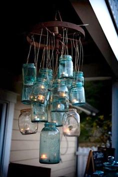 My ultimate favourite deco item - Mason Jars! Rustic Chandelier made from a few old Mason Jars; just on their own as a deco item or a suave rustic chandelier! Mason Jar Chandelier, Mason Jar Lamp, Rustic Chandelier, Lantern Chandelier, Outdoor Chandelier, Jar Lanterns, Jar Candles, Ring Chandelier, Primitive Home Decorating