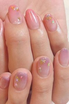 This manicure trend is seriously everywhere right now. It's time to up your nail art game ASAP. We love this pale pink with star detail...